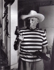 Picasso with pistol and cowboyhat, given to him by Gary Cooper, 1958